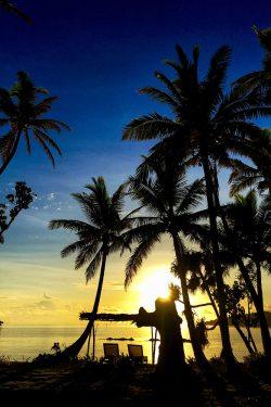 coconut-beach-resort-beach-sun-setting-gold