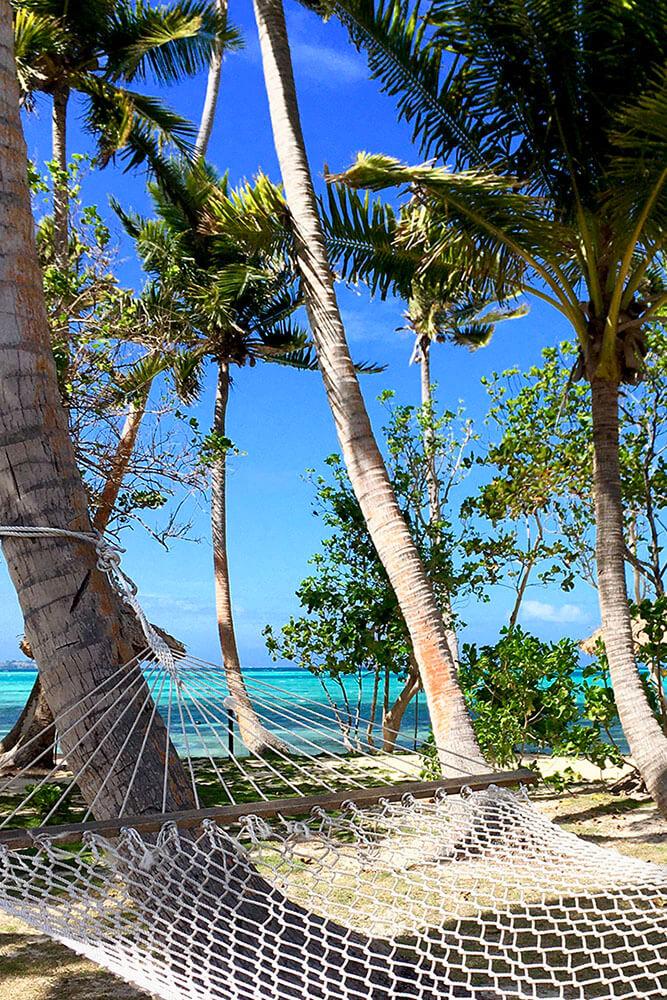 coconut-beach-resort-grounds-relax-on-hammock